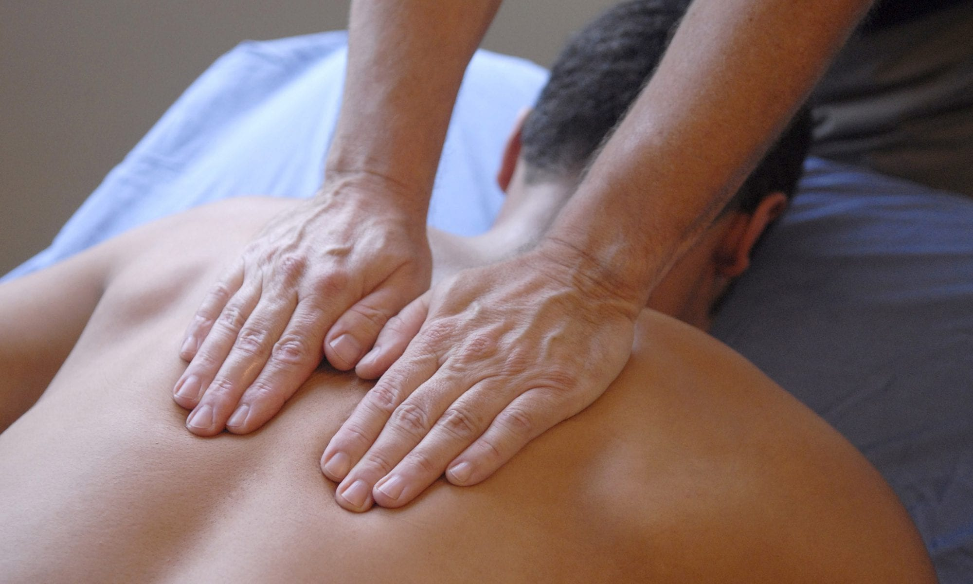 Massage man's back